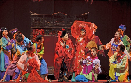 CHENGDU - JUN 8: Chinese Shao opera performer make a show on stage to compete for awards in 25th Chinese Drama Plum Blossom Award competition at Jincheng theater.Jun 8, 2011 in Chengdu, China. Chinese Drama Plum Blossom Award is the highest theatrical awa