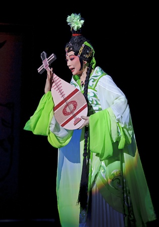 customary: CHENGDU - JUN 6: Chinese Gaojia Opera performer make a show on stage to compete for awards in 25th Chinese Drama Plum Blossom Award competition at Jinsha theater.Jun 6, 2011 in Chengdu, China. Chinese Drama Plum Blossom Award is the highest theatrical awa