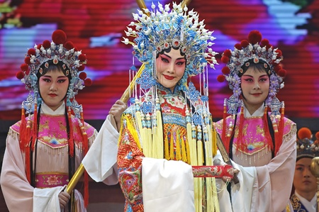 CHENGDU - JUN 4: chinese Hui opera performer make a show on stage to compete for awards in 25th Chinese Drama Plum Blossom Award competition at Xinan theater.Jun 4, 2011 in Chengdu, China.Chinese Drama Plum Blossom Award is the highest theatrical award i Stock Photo - 10405005