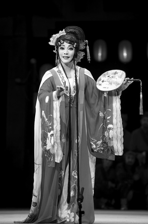customary: CHENGDU - JUN 4: chinese Sichuan opera performer make a show on stage to compete for awards in 25th Chinese Drama Plum Blossom Award competition at Xinan theater.Jun 4, 2011 in Chengdu, China. Chinese Drama Plum Blossom Award is the highest theatrical awa
