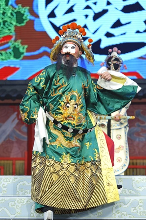 customary: CHENGDU - JUN 4: chinese traditional theatrical clown performs on stage at Xinan theater.Jun 4, 2011 in Chengdu, China. Editorial