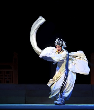 CHENGDU - JUN 6: Mulian Drama of Chinese Qi opera performer make a show on stage to compete for awards in 25th Chinese Drama Plum Blossom Award competition at Experimental theater.Jun 6, 2011 in Chengdu, China. Stock Photo - 10435152