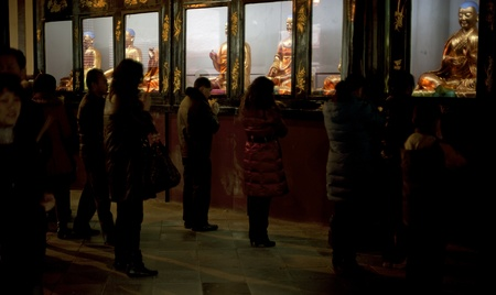 traditional custom: CHENGDU - FEB 14: People praying to Buddha in temple during chinese new year on Feb 14, 2010 in Chengdu, China. Its part of the important traditional custom in China.  Editorial