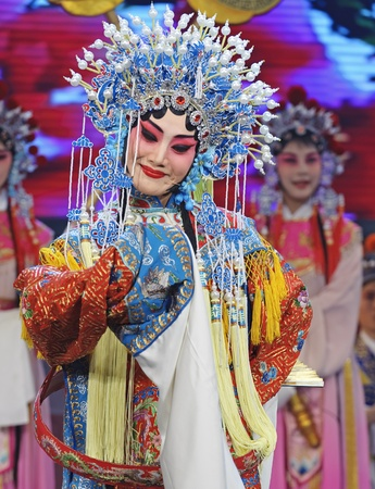 CHENGDU - JUN 4: chinese Hui opera performer make a show on stage to compete for awards in 25th Chinese Drama Plum Blossom Award competition at Xinan theater.Jun 4, 2011 in Chengdu, China.Chinese Drama Plum Blossom Award is the highest theatrical award i