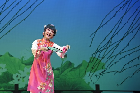 CHENGDU - JUN 3: chinese Yue opera performer make a show on stage to compete for awards in 25th Chinese Drama Plum Blossom Award competition at Experimental theater.Jun 3, 2011 in Chengdu, China.Chinese Drama Plum Blossom Award is the highest theatrical a Editorial