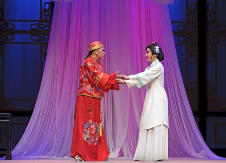 CHENGDU - JUN 3: chinese Yue opera performer make a show on stage to compete for awards in 25th Chinese Drama Plum Blossom Award competition at Experimental theater.Jun 3, 2011 in Chengdu, China.Chinese Drama Plum Blossom Award is the highest theatrical a Stock Photo - 10500190