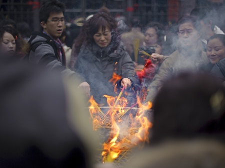 traditional custom: CHENGDU - FEB 14: People burning incense upon the incense altar in temple during chinese new year on Feb 14, 2010 in Chengdu, China. It is part of the important traditional custom in China.