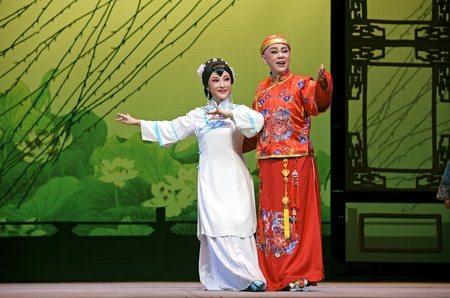 CHENGDU - JUN 3: chinese Yue opera performer make a show on stage to compete for awards in 25th Chinese Drama Plum Blossom Award competition at Experimental theater.Jun 3, 2011 in Chengdu, China. Editorial