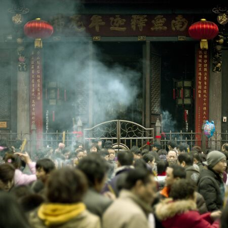 traditional custom: CHENGDU - FEB 14: People burning incense upon the incense altar in temple during chinese new year on Feb 14, 2010 in Chengdu, China. It is part of the important traditional custom in China. Editorial
