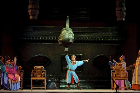 customary: CHENGDU - JUN 8: Chinese Shao opera performer make a show on stage to compete for awards in 25th Chinese Drama Plum Blossom Award competition at Jincheng theater.Jun 8, 2011 in Chengdu, China. Chinese Drama Plum Blossom Award is the highest theatrical awa Editorial