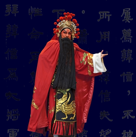 customary: CHENGDU - JUN 1: chinese Beijing opera performer make a show on stage to compete for awards in 25th Chinese Drama Plum Blossom Award competition at Shengge theater.Jun 1, 2011 in Chengdu, China. Chinese Drama Plum Blossom Award is the highest theatrical a
