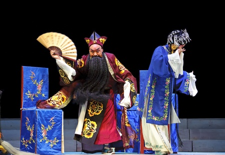 customary: CHENGDU - JUN 6: Mulian Drama of Chinese Qi opera performer make a show on stage to compete for awards in 25th Chinese Drama Plum Blossom Award competition at Experimental theater.Jun 6, 2011 in Chengdu, China. Editorial