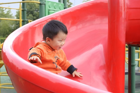 baby playing on sliding board Stock Photo - 10690950