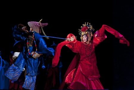 CHENGDU - JUN 3: chinese Cantonese opera performer make a show on stage to compete for awards in 25th Chinese Drama Plum Blossom Award competition at Jinsha theater.Jun 3, 2011 in Chengdu, China.Chinese Drama Plum Blossom Award is the highest theatrical  Stock Photo - 10753281