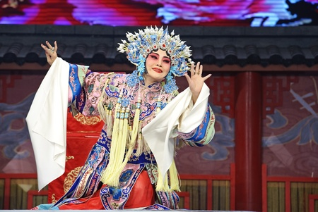 CHENGDU - JUN 4: chinese Hui opera performer make a show on stage to compete for awards in 25th Chinese Drama Plum Blossom Award competition at Xinan theater.Jun 4, 2011 in Chengdu, China.Chinese Drama Plum Blossom Award is the highest theatrical award i Stock Photo - 10753299