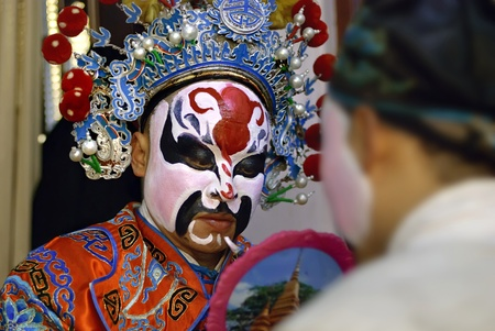 facial painting: china opera actor is facial painting backstage Stock Photo