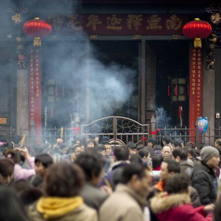 traditional custom: CHENGDU - FEB 14: People burning incense upon the incense altar in temple during chinese new year on Feb 14, 2010 in Chengdu, China. Its part of the important traditional custom in China.  Editorial