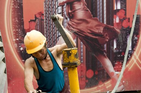 hardworking laborer on construction site Stock Photo - 10938425