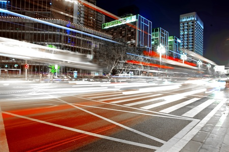 High speed and blurred bus light trails in downtown nightscape Stock Photo - 11201256