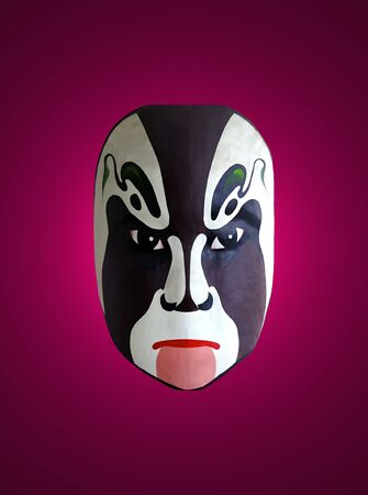 chinese opera: mask of opera with red isolated background