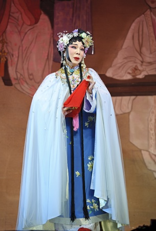 elegancy: CHENGDU - JUN 3: chinese Cantonese opera performer make a show on stage to compete for awards in 25th Chinese Drama Plum Blossom Award competition at Jinsha theater.Jun 3, 2011 in Chengdu, China. Chinese Drama Plum Blossom Award is the highest theatrical  Editorial