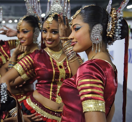 tribal woman: CHENGDU - MAY 29:Sri Lankan girls perform traditional dance in the 3rd International Festival of the Intangible Cultural Heritage.May 29, 20011 in Chengdu, China.