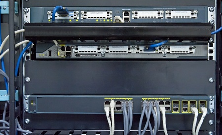 Network hub and patch cables in network cabinet photo