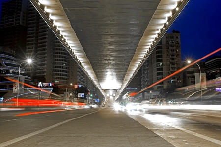 flyover: city night scene : flyover,light and hurtling car
