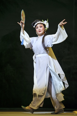CHENGDU - MAY 31: chinese Yue opera performer make a show on stage to compete for awards in 25th Chinese Drama Plum Blossom Award competition at Experimental theater.May 31, 2011 in Chengdu, China.Chinese Drama Plum Blossom Award is the highest theatrica Stock Photo - 11336399