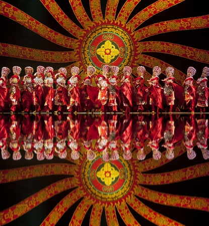 CHENGDU - OCT 17: Chinese Yi national dancers perform folk dance on stage at JINCHENG theater on Oct 17, 2011 in Chengdu, China. Editorial