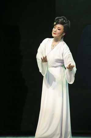CHENGDU - MAY 31: chinese Yue opera performer make a show on stage to compete for awards in 25th Chinese Drama Plum Blossom Award competition at Experimental theater.May 31, 2011 in Chengdu, China. Chinese Drama Plum Blossom Award is the highest theatrica Editorial