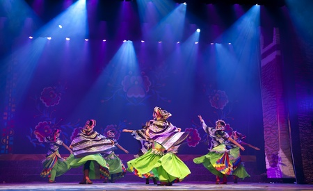 CHENGDU - SEP 27: chinese Tibetan ethnic dancers perform on stage at experimental theater.Sep 27,2010 in Chengdu, China.