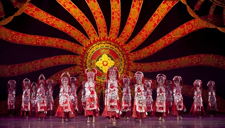 CHENGDU - OCT 18: Chinese Yi national dancers perform folk dance on stage at JINCHENG theater on Oct 18, 2011 in Chengdu, China.