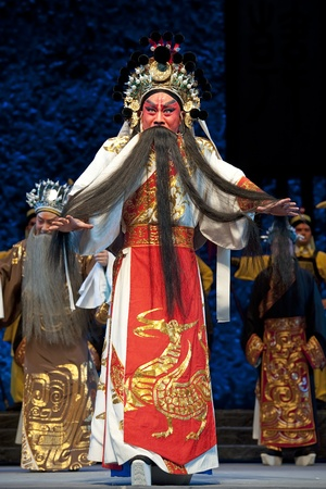 CHENGDU - JUN 1: chinese Beijing opera performer make a show on stage to compete for awards in 25th Chinese Drama Plum Blossom Award competition at Shengge theater.Jun 1, 2011 in Chengdu, China.