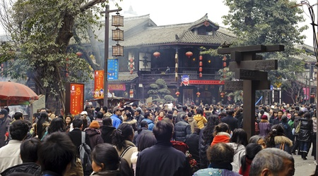 CHENGDU - FEB 14: crowded People waiting to enter a temple to pray to Buddha during chinese new year on Feb 14, 2010 in Chengdu, China. Its part of the important traditional custom in China.