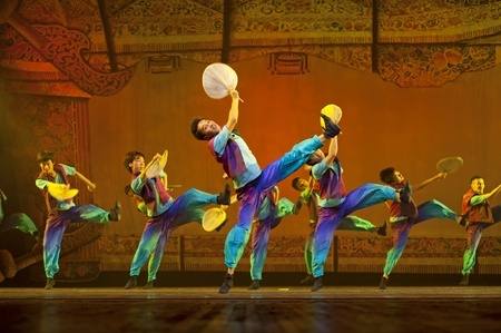 CHENGDU - OCT 17: Chinese national dancers perform folk dance\ on stage at JINCHENG theater on Oct 17, 2011 in Chengdu, China.\