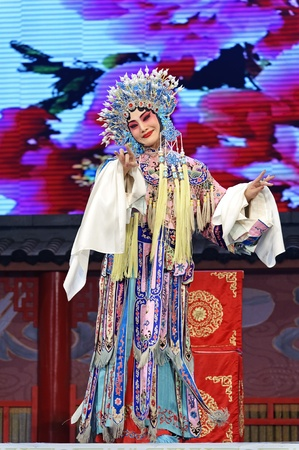 CHENGDU - JUN 4: chinese Hui opera performer make a show on stage to compete for awards in 25th Chinese Drama Plum Blossom Award competition at Xinan theater.Jun 4, 2011 in Chengdu, China.Chinese Drama Plum Blossom Award is the highest theatrical award i Stock Photo - 12143241