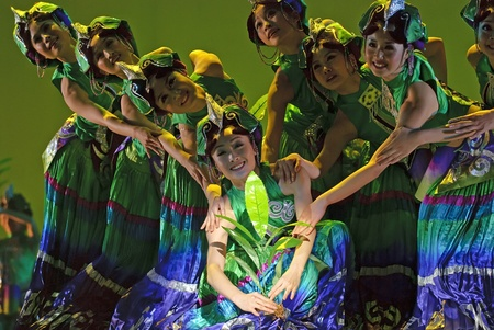 CHENGDU - DEC 20: Chinese dancers perform ethnic group dance on stage at JINCHENG theater in the 7th national dance competition of china on Dec 20,2007 in Chengdu, China.