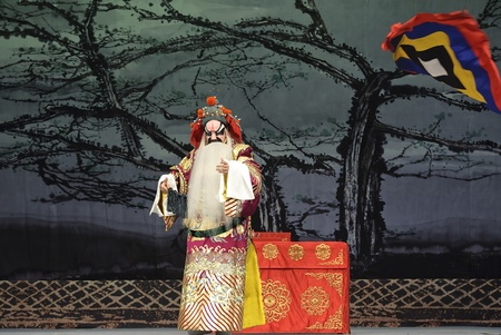 exaggerate: chinese Beijing opera actor performs onstage