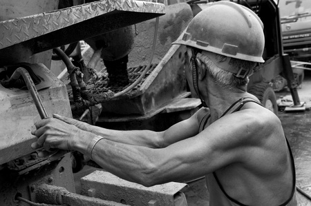 hardworking laborer on construction site photo