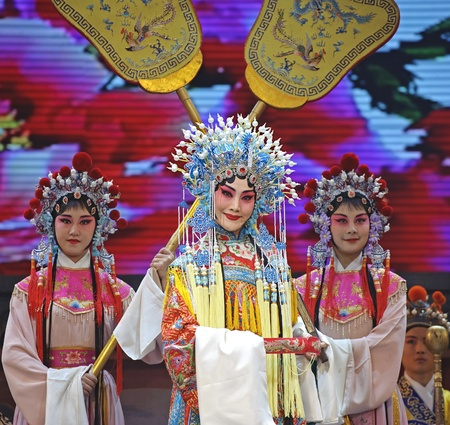 CHENGDU - JUN 4: chinese Hui opera performer make a show on stage to compete for awards in 25th Chinese Drama Plum Blossom Award competition at Xinan theater.Jun 4, 2011 in Chengdu, China. Chinese Drama Plum Blossom Award is the highest theatrical award i