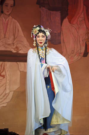 CHENGDU - JUN 3: chinese Cantonese opera performer make a show on stage to compete for awards in 25th Chinese Drama Plum Blossom Award competition at Jinsha theater.Jun 3, 2011 in Chengdu, China. Chinese Drama Plum Blossom Award is the highest theatrical