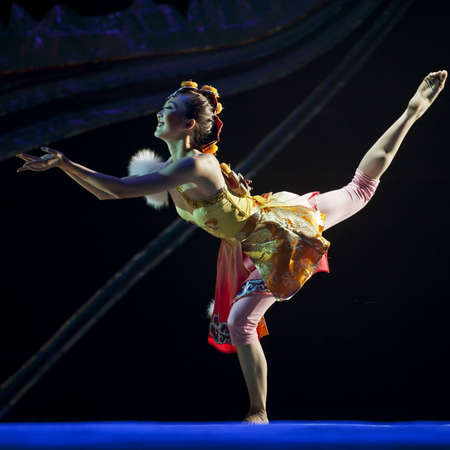 CHENGDU - OCT 17: Tibetan national dancer performs folk dance on stage at JINCHENG theater on Oct 17, 2011 in Chengdu, China.
