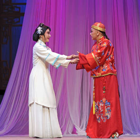CHENGDU - JUN 3: chinese Yue opera performer make a show on stage to compete for awards in 25th Chinese Drama Plum Blossom Award competition at Experimental theater.Jun 3, 2011 in Chengdu, China. Chinese Drama Plum Blossom Award is the highest theatrical  Editorial
