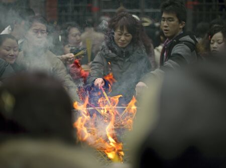 CHENGDU - FEB 14: People burning incense upon the incense altar in temple during chinese new year on Feb 14, 2010 in Chengdu, China. Its part of the important traditional custom in China.