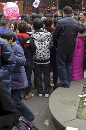 CHENGDU - FEB 14: crowded People waiting in line to enter a temple to pray to Buddha during chinese new year on Feb 14, 2010 in Chengdu, China.