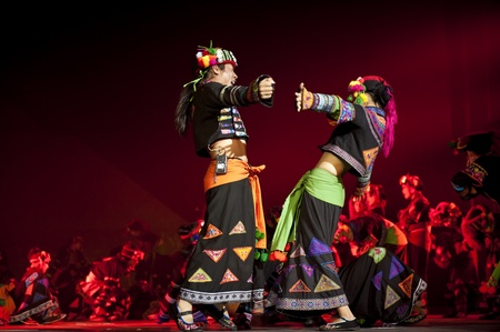 CHENGDU - OCT 27: chinese national dancers perform traditional dance Dynamic Yunnan on stage at Jincheng theater.Oct 27, 2011 in Chengdu, China.