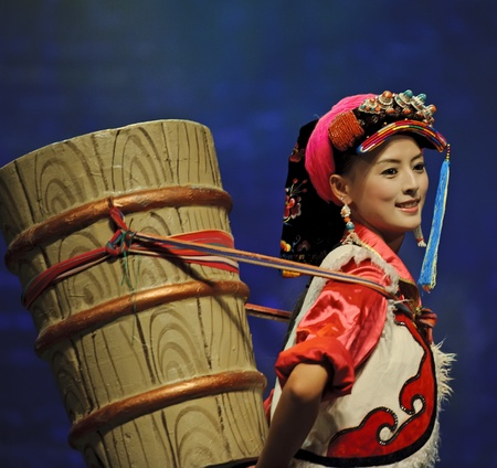 CHENGDU - SEP 27: chinese Tibetan ethnic dancer performs on stage at Sichuan experimental theater.Sep 27,2010 in Chengdu, China. Stock Photo - 12936006