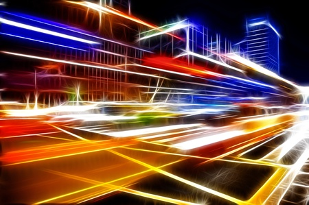 overpass: High speed and blurred bus light trails in downtown nightscape Stock Photo