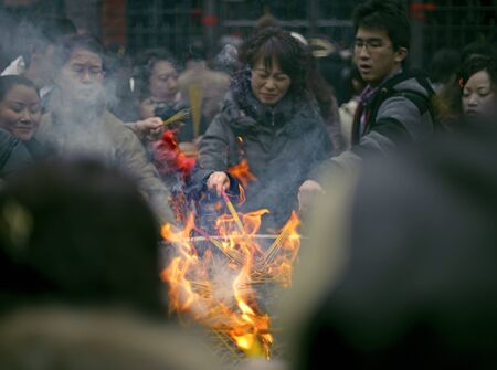 CHENGDU - FEB 14: People burning incense upon the incense altar in temple during chinese new year on Feb 14, 2010 in Chengdu, China.